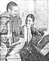 "George Hoven (left) and Chester Shull work out on a new melody. Their song, ""Sin,"" is one of the favorites on the hit parade."