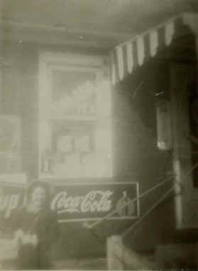 This photo shows my sister Peggy in front of the original store.