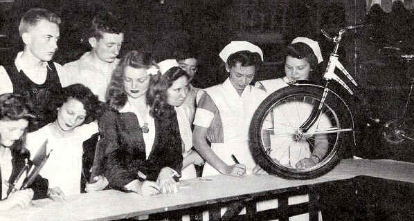 Hoping for the shiny bike are Marion Taylor, Florence Newell, Anna Mae Fisher, Dorothy Brizendine, Josephine La Placca and Ruth Townsley. Behind them are Wesley McDowell and Jim Glenney.  Photo from The Delaware County Advocate - June 1942