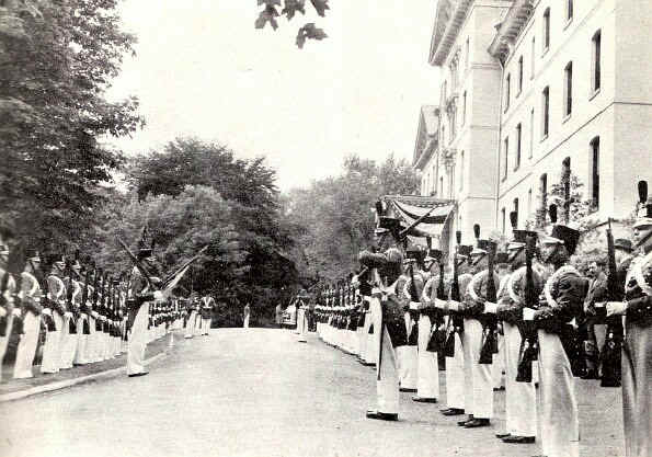 The cadet corps forms a guard of honor in front of Old Main just before the Academic Procession starts. - Photo from The Delaware County Advocate, June 1942